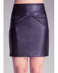 Bebe Faux Leather Bow Skirt - Lyst