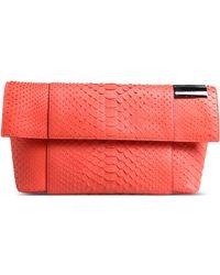 Victoria Beckham Clutches pink - Lyst