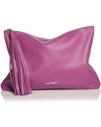 Lacambra Tassel Fuchsia Leather Clutch - Lyst