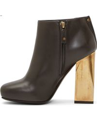Lanvin Black Leather Gold Heel Boots - Lyst