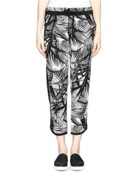 Elizabeth And James 'Evelyna' Palm Tree Print Silk Track Pants black - Lyst