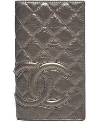 Chanel Pre-Owned Bronze Metallic Lambskin Cambon Ligne Bi-Fold Wallet - Lyst