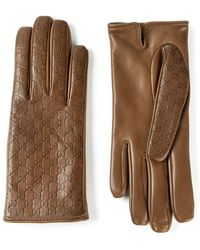 Gucci Logo Embossed Gloves - Lyst