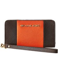 Michael by Michael Kors Jet Set Travel Center Stripe Slim Tech Wristlet - Lyst