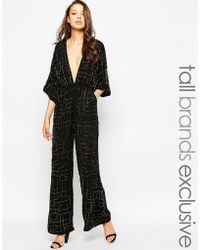 True Decadence Plunge Front Embellished Palazzo Jumpsuit - Black