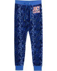 Juicy Couture Snake Print Slim Leisure Pants - Lyst