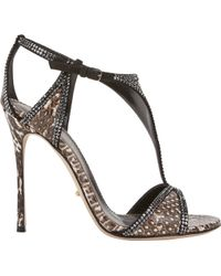 Sergio Rossi Snake Crystalembellished Tstrap Sandals - Lyst