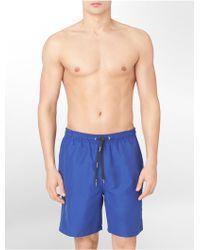 Calvin Klein Solid Swim Trunk - Lyst