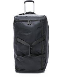 "Lipault Foldable 2 Wheeled 30"" Duffel Bag - Black"