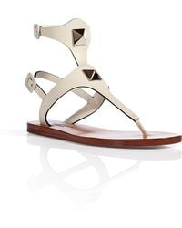 Valentino Leather Thong Sandals with Rockstud Embellishment - Lyst