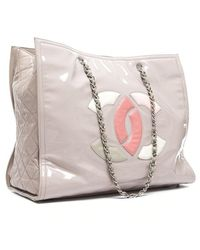 Chanel Preowned Beige Patent Vinyl Lipstick Tote Bag - Lyst