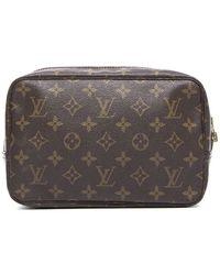 Louis Vuitton Pre-owned Monogram Canvas Trousse 23 Cosmetic Bag - Lyst