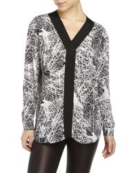 Symple NYC - Surplice Printed Woven Blouse - Lyst