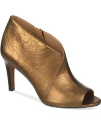 Franco Sarto Gold Tiff Booties - Lyst