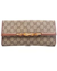 Gucci Preowned Beige Monogram Canvas Bamboo Clutch - Lyst