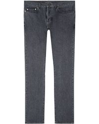 Saint Laurent Washed Skinny Jeans - Lyst