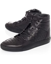 Balenciaga Monochrome Debossed Leather High Top Sneakers - Lyst
