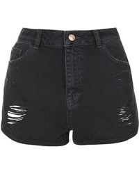 Topshop Moto Black Denim Ripped Hotpants - Lyst