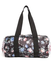 Herschel Supply Co. Packable Duffle Bag in All Over Fine China Floral Print - Multicolour