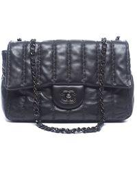 Chanel Preowned Black Lambskin Vertical Stitch Medium Flap Bag - Lyst