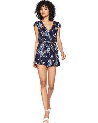 5f3898ef1f8 Lyst - Asos Cap Sleeve Playsuit In Floral Print