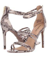 f89b3bec8b5 Lyst - Bebe Naddia Strappy Sandals in Metallic