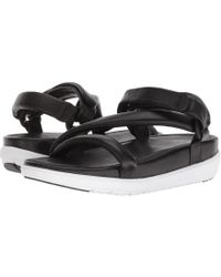 b5087e812daa Lyst - Fitflop Loosh Luxetm Leather Slide Sandals in Black - Save 29%