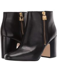 d85bc11ece9 Lyst - Michael Michael Kors Studded Cutout Ankle Booties in Black