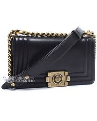 Chanel Pre-Owned Black Leather Small Boy Bag black - Lyst