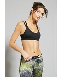 "d5d40cd0dc Lyst - Forever 21 Low Impact €"" Strappy Sports Bra in Black"