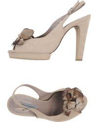 Vic Sandals beige - Lyst