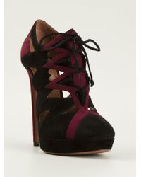 Alaïa Ankle Boots black - Lyst