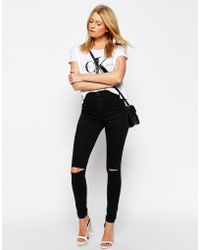Asos Rivington High Waist Denim Jeggings In Washed Black With Ripped Knees - Lyst