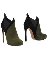 Alaïa Shoe Boots green - Lyst