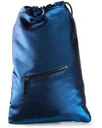 Jil Sander Drawstring Metallic Sheen Backpack - Lyst