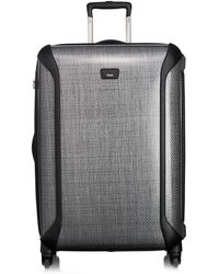 Tumi Large Trip Packing Case 4-Wheel Grey Suitcase - Lyst
