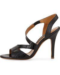 Kay Unger Valorie Asymmetric Snakeskin Sandal black - Lyst