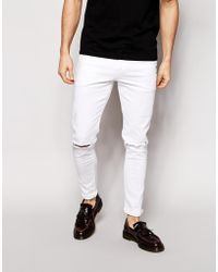 Asos Super Skinny Jeans With Knee Rips - Lyst