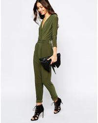 Never Fully Dressed - Deep Plunge Neck Jumpsuit With Wrap Front And 3/4 Sleeve - Lyst