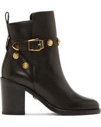 Versace Black Leather Logo Studded Ankle Boots - Lyst