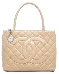 Chanel Pre-owned Beige Caviar Medallion Tote Bag - Lyst