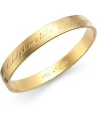 Kate Spade Gold-Tone You And Me Engraved Idiom Bangle Bracelet - Lyst