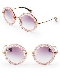 Miu Miu Noir Round Sunglasses - Lyst