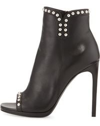 Saint Laurent Studded Leather Peep-Toe Bootie - Lyst