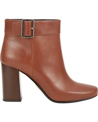 Prada Side-Buckle Ankle Boots - Lyst