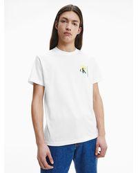 Calvin Klein T-Shirt mit Palmen-Print aus Bio-Baumwolle - Weiß