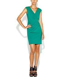 Nicole Miller Asymmetrical Pleated Cap Sleeve Dress - Lyst