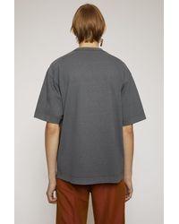 Acne Studios T-shirt avec logo inversé - Gris