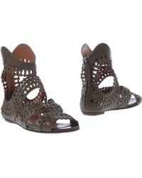 Alaïa Khaki Ankle Boots - Lyst
