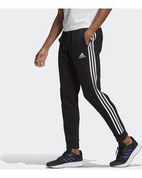adidas Essentials Fleece Tapered Cuff 3-stripes Broek - Zwart